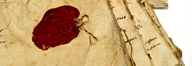 nico europe unternehmen company historie history rotes wachssiegel auf stapel altertümlicher beschrifteter pergamentbögen