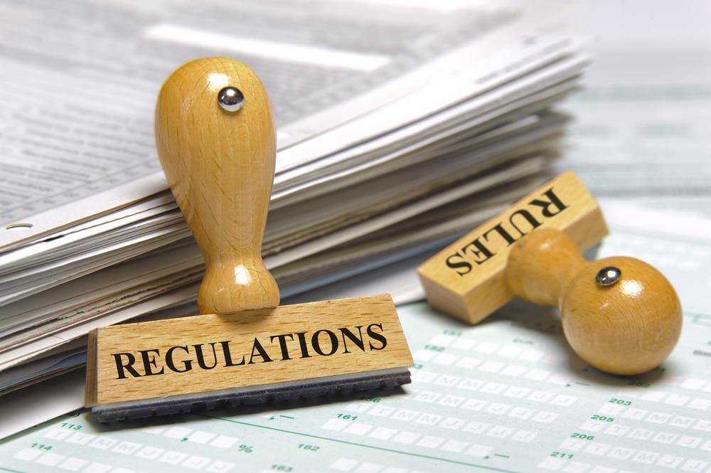 nico europe info gesetzliche bestimmungen stempel mit aufschrift rules und regulations angelehnt an formularstapel