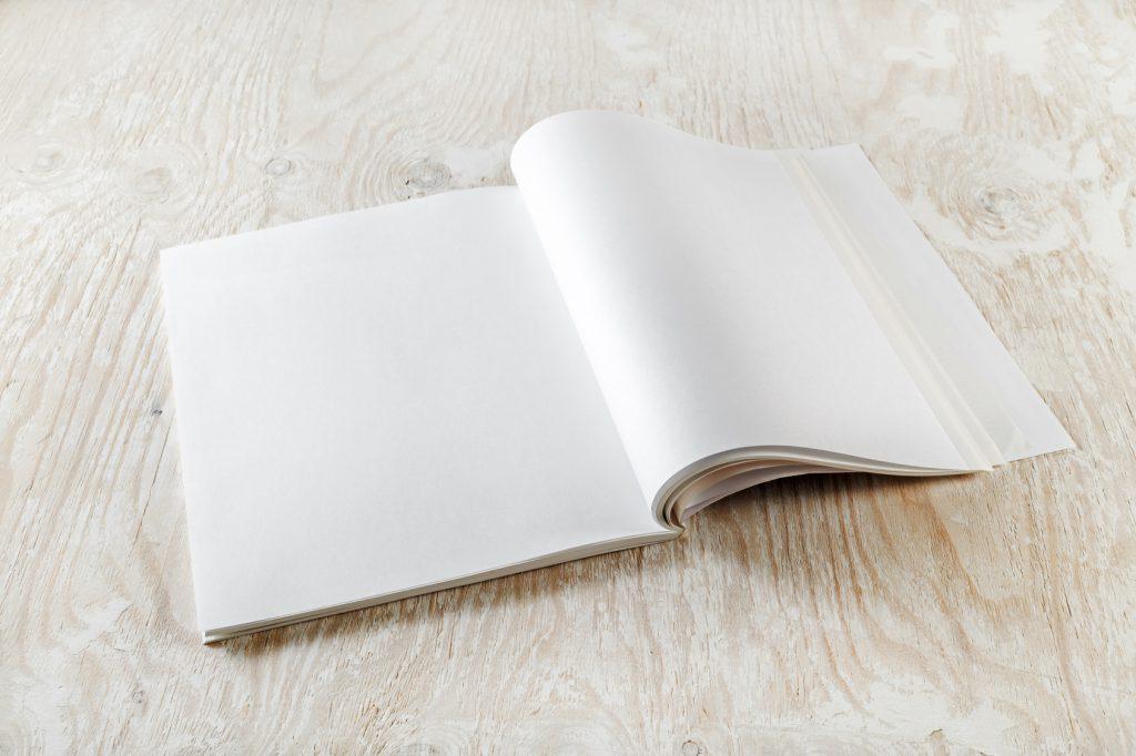 nico europe b2b kataloge catalogues aufgeschlagenes blanko booklet auf heller holzfläche