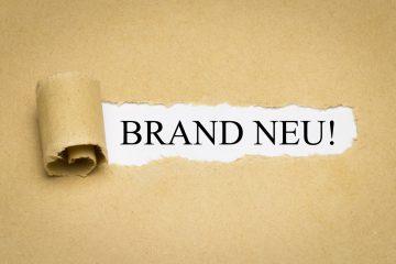 """nico europe teaser neuheiten aufgerissenes packpapier mit schriftzug """"brandneu"""""""